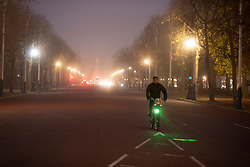 © Licensed to London News Pictures. 30/11/2020. London, UK. A man cycles on The Mall during a foggy morning in central London. Parts of the UK are experiencing heavy fog and low temperatures. Photo credit: George Cracknell Wright/LNP