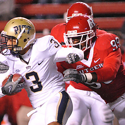 Oct 16, 2009; Piscataway, NJ, USA; Rutgers defensive end Jonathan Freeny (99) catches and tackled Pittsburgh wide receiver Aaron Smith (3) during first half NCAA football action in Pittsburgh's 24-17 victory over Rutgers at Rutgers Stadium.