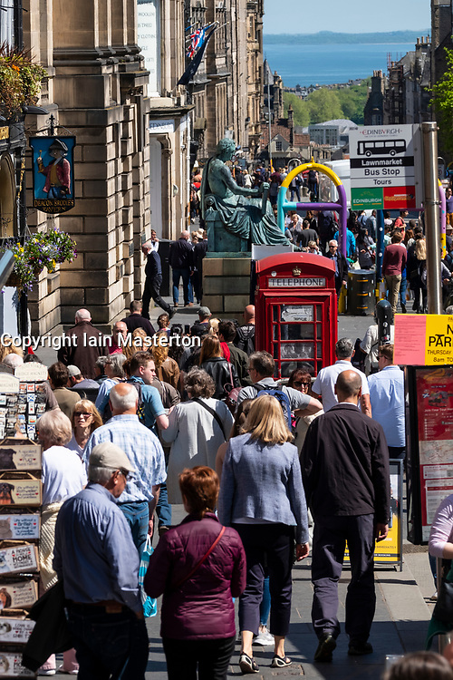 View along the Royal Mile with many tourists  in Old Town of Edinburgh, Scotland, UK