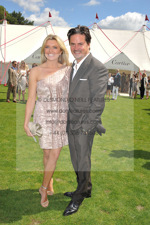 TINA HOBLEY and OLIVER WHEELR at the 27th annual Cartier International Polo Day featuring the 100th Coronation Cup between England and Brazil held at Guards Polo Club, Windsor Great Park, Berkshire on 24th July 2011.