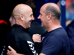Rangers assistant manager Gary McAllister (left) and Wigan manager Paul Cook (right) during the pre-season friendly match at Ibrox Stadium, Glasgow.