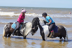 © Licensed to London News Pictures. 12/06/2021.Formby, UK. Cara Cook,43 and Sam Cook,13,enjoy the hot weather on Formby beach in Merseyside. Photo credit: Ioannis Alexopoulos/LNP