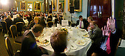 Gordon Brown sitting with Robert Olsen, Jim Naughtie on right. Political Studies Association Awards 2004. Institute of Directors, Pall Mall. London SW1. 30 November 2004.  ONE TIME USE ONLY - DO NOT ARCHIVE  © Copyright Photograph by Dafydd Jones 66 Stockwell Park Rd. London SW9 0DA Tel 020 7733 0108 www.dafjones.com