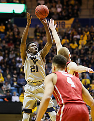 Jan 6, 2018; Morgantown, WV, USA; West Virginia Mountaineers forward Wesley Harris (21) shoots a three pointer during the second half against the Oklahoma Sooners at WVU Coliseum. Mandatory Credit: Ben Queen-USA TODAY Sports