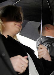 © Licensed to London News Pictures. 07/04/2014; Bristol, UK.  School teacher Kelly Ann-Marie Burgess (under umbrella) age 26 from Newport in South Wales attends Bristol Crown Court for sentencing having pleaded guilty of offences of adult abuse of trust for sexual activity against a teenage boy.  She has been suspended from her job at a school in North Somerset.<br /> Photo credit: Simon Chapman/LNP