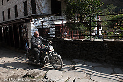 Scotty Busch on the main street of Tatopani starting out on Day-7 of our Himalayan Heroes adventure riding from Tatopani to Pokhara, Nepal. Monday, November 12, 2018. Photography ©2018 Michael Lichter.