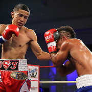"""Samuel Rodriguez (right) fights Jayron Santiago during a """"Boxeo Telemundo""""  boxing match at the Kissimmee Civic Center on Friday, July 18, 2014 in Kissimmee, Florida. Rodriguez won the bout. (AP Photo/Alex Menendez)"""