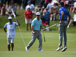June 24, 2018 - Cromwell, CT, USA - Stewart Cink, right, jumps on the 17th green after narrowly missing birdie during the final round of the Travelers Championship at TPC River Highlands in Cromwell, Conn., on Sunday, June 24, 2018. (Credit Image: © Brad Horrigan/TNS via ZUMA Wire)