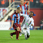 Trabzonspor's Serkan BALCI (L) and CSKA Moskva's Vagner LOVE (R) during their UEFA Champions League group stage matchday 4 soccer match Trabzonspor between CSKA Moskva at the Avni Aker Stadium at Trabzon Turkey on Wednesday, 02 November 2011. Photo by TURKPIX