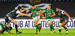 Sebastian Negri of Benetton Treviso evades the tackle of Adam Beard of Ospreys<br /> <br /> Photographer Craig Thomas/Replay Images<br /> <br /> Guinness PRO14 Round 4 - Ospreys v Benetton Treviso - Saturday 22nd September 2018 - Liberty Stadium - Swansea<br /> <br /> World Copyright © Replay Images . All rights reserved. info@replayimages.co.uk - http://replayimages.co.uk