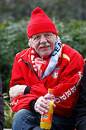 A Liverpool fan relaxes outside the stadium prior to kick off. Capital One Cup Final, Liverpool v Manchester City at Wembley stadium in London, England on Sunday 28th Feb 2016. pic by Chris Stading, Andrew Orchard sports photography.