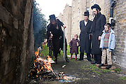 On the first day of Passover Orthodox Jewish men burn Chamets and the tools used to collect the Chamets on a fire in their garden. While burning these items they recite prayers.