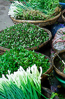 Leafy green garden fresh vegetables for sale in a street market in Hoi An's old town.