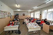 Children during a lesson at Primary school No 10. Members of the National Assembly of the Nagorno-Karabakh Republic are working on a draft law to make Russian the second official language of Nagorno Karabakh, the first one being Armenian. Children of Primary School Number Ten are learning at the renovated building, which was damaged in shelling attacks during 44 days of the war in Stepanakert, Nagorno-Karabakh. The region saw an end of the conflict after a ceasefire agreement was signed by the leaders of Armenia, Russia and Azerbaijan on 9 November to end the military conflict in Nagorno-Karabakh. Azerbaijani government established the Karabakh Region Authority (KRU) for the districts of Nagorno-Karabakh that came under Baku's control. The city of Stepanakert (Khankendi) is now under the jurisdiction of the KRU of the Ministry of Justice of Azerbaijan. (Photo/ Vudi Xhymshiti)