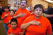 Nov. 11, 2009 -- PHOENIX, AZ: ELVA LETECIA (right) and members of her family say the Pledge of Allegiance during a meeting of members of the UFCW at the Airport Marriott Hotel in Phoenix. The United Food and Commercial Workers Union (UFCW) Local 99 has about 25,000 members in Arizona: 15,000 in Fry's grocery stores and Fry's Marketplace, 9,500 in Safeway stores and 400 in Smith's grocery stores. The union voted down the last proposal from the stores and has announced plans to go on strike at 6PM on Friday, Nov. 13. The meeting Wednesday is the last one before the strike.   Photo by Jack Kurtz