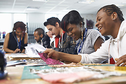 May 14, 2014 - Group of students at table in textile class (Credit Image: © Image Source/Image Source/ZUMAPRESS.com)