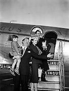 """Josef Locke, Radio and Stage Star, arriving at Collinstown Airport for Radio Review.24/03/1955..Josef Locke was the stage name of Joseph McLaughlin (23 March 1917 - 15 October 1999), a tenor singer who was successful in the United Kingdom and Ireland in the 1940s and 1950s..Born in Derry, he was the son of a butcher and cattle dealer, and one of nine children. He started singing in local churches in the Bogside at the age of seven, and as a teenager added two years to his age to enlist in the Irish Guards, later serving abroad with the Palestine Police Force, before returning in the late 1930s to join the Royal Ulster Constabulary. Known as The Singing Bobby, he became a local celebrity before starting to work the UK variety circuit, where he played 19 seasons in the northern English seaside resort of Blackpool. The renowned Irish tenor John McCormack (1884-1945) advised him that his voice was better suited to a lighter repertoire than the operatic one he had in mind, and urged him to find an agent?thus he found the noted impresario Jack Hylton (1892-1965) who booked him, but couldn't fit his full name on the bill, thus Joseph McLaughlin became Josef Locke..He made his first radio broadcast in 1949, and subsequently appeared on TV programmes such as Rooftop Rendezvous, Top of the Town, All-star Bill and The Frankie Howerd Show. He was signed to the Columbia label in 1947, and his first releases were the two Italian songs """"Santa Lucia"""" and """"Come Back to Sorrento""""."""