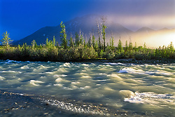 Midnight sun aureoles over the Snake River, Yukon