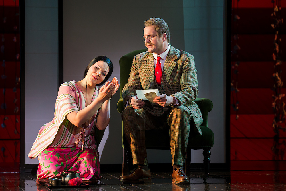 """LONDON, UK, 14 May, 2016. Rina Harms (lefy, as Butterfly) and George von Bergen (as Sharpless) rehearse for the revival of director Anthony Minghella's production of Puccini's opera """"Madam Butterfly"""" at the London Coliseum for the English National Opera. The production opens on 16 May. Photo credit: Scott Rylander."""