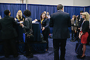 Kelly Sweeney, right, waits to have her book signed by Ann Coulter and during the final day of the Conservative Political Action Conference (CPAC) at the Gaylord National Resort & Convention Center in National Harbor, Md.