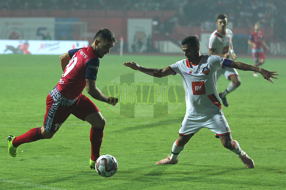 Carlos Calvo of Jamshedpur FC tries to hit shot during match 25 of the Hero Indian Super League 2018 ( ISL ) between Jamshedpur FC and FC Goa held at JRD Tata Sports Complex, Jamshedpur, India on the 1st November  2018<br /> <br /> Photo by: Deepak Malik /SPORTZPICS for ISL