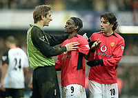 Louis Saha (Utd) talks over the penalty incident with Edwin Van der Sar. Ruud Van Nistelrooy (right). Fulham v Manchester United. 28/2/04. Credit :Digitalsport/Andrew Cowie.