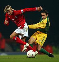 Photo. Javier Garcia<br />12/02/2003 England v Australia, Friendly International, Upton Park<br />David Beckham is stopped in his tracks by Josip Skoko