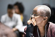 A participant listens during the session Promoting Female Leadership at the World Forum World Economic Forum on Africa 2019. Copyright by World Economic Forum / Greg Beadle