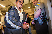 02 MARCH 2006 - Undocumented immigrants apprehended by the Maricopa County Sherrif's Dept. walk into the Madison Street Jail Thursday night. Fiftyfour immigrants were apprehended by MCSO deputies. PHOTO BY JACK KURTZ