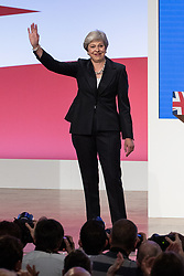 © Licensed to London News Pictures . 03/10/2018. Birmingham, UK. Prime Minister THERESA MAY leaves the conference waving after the leaders' speech . Day 4 of the Conservative Party conference at the ICC in Birmingham . Photo credit: Joel Goodman/LNP