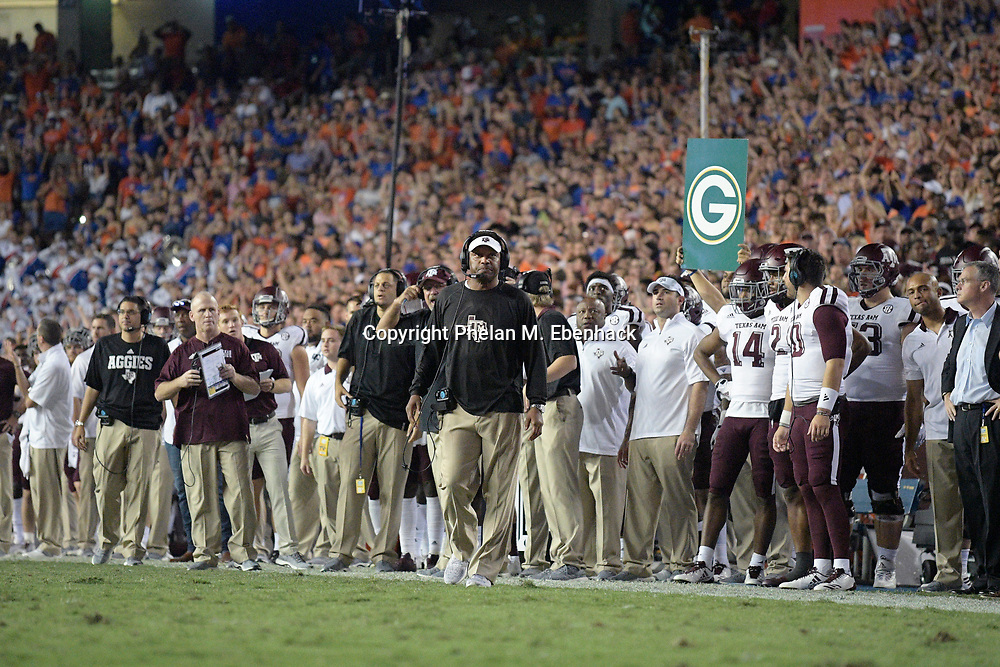 Texas A&M head coach Kevin Sumlin, center, reacts on the sideline during the second half of an NCAA college football game against Florida Saturday, Oct. 14, 2017, in Gainesville, Fla. Texas A&M won 19-17. (Photo by Phelan M. Ebenhack)