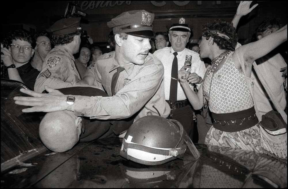 Police make an arrest in the aftermath of a large protest after Wigstock in 1989. Mark Carson of ACT UP was arrested when NYPD claimed he was interfering with the arrest of two men who had attacked Karl Soehnlein, Alan Klein and Darren Britton with lacrosse sticks. His arrest prompted a protest march of 200 people to the 9th Precinct, (though he'd actually been taken to the 7th Precinct)