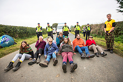 © Licensed to London News Pictures. 20/09/2017. Kirby Misperton UK. Protesters block the road leading to the Kirby Misperton KM8 fracking site this morning as a second day of protests have started. It is thought that equipment to erect noise barriers is being bought in. Third Energy was granted planning permission last year to frack the site but has not yet received final consent to begin fracking, but expects to start before the end of the year. are Photo credit: Andrew McCaren/LNP
