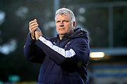 AFC Wimbledon manager Glyn Hodges clapping hands during the EFL Sky Bet League 1 match between AFC Wimbledon and Fleetwood Town at the Cherry Red Records Stadium, Kingston, England on 8 February 2020.
