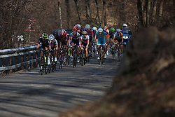 A second group approaches further down the road in the long loop of the Trofeo Alfredo Binda - a 123.3km road race from Gavirate to Cittiglio on March 20, 2016 in Varese, Italy.