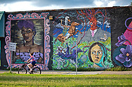 Woman riding her bike alone in New Orleans during a shelter in place order due to the coronavirus pandemic.