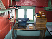 """In the Argentine Islands, Antarctica, Wordie House (1947-1954) has been restored and is designated under the Antarctic Treaty System as Historic Site and Monument No. 62. An old manual typewriter and """"dog cards"""" bin rest on a desk. The United Kingdom first established meteorological research here as Base F or """"Argentine Islands"""" on Winter Island in 1947. The main hut, built on the site of an earlier British Graham Land Expedition hut, was named after Sir James Wordie, a member of Shackleton's Imperial Trans-Antarctic Expedition who visited during its construction. The original main hut, """"Wordie House,"""" now comprises the kitchen and bunk room. The base was extended in 1951 to include a generator shed, office, store, and toilet. A larger hut was built on nearby Galindez Island in 1954 and renamed Faraday Station in 1977. Researchers at Faraday Station shocked the scientific community by discovering the Antarctic """"ozone hole"""" in 1985. Operational transfer to Ukraine in 1996 renamed Faraday Station to Vernadsky Research Base (Akademik Vernadsky)."""