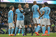 The referee gives a penalty for the handball by Raheem Sterling (Manchester City) during the Barclays Premier League match between Manchester City and Tottenham Hotspur at the Etihad Stadium, Manchester, England on 14 February 2016. Photo by Mark P Doherty.