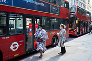 People wearing face masks on public transport by TfL buses on the day that it was announced that the Coronavirus lockdown measures are set to ease even further and the quiet city starts coming to an end, on 23rd June 2020 in London, England, United Kingdom. As of today the government has relaxed its lockdown rules, and is allowing some non-essential shops to open with individual shops setting up social distancing queueing systems.