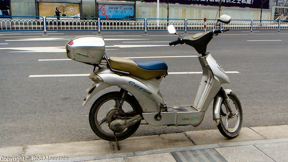 The electric moped. A common sight in China.