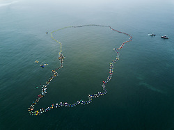 Jun 20, 2017 - Huntington Beach, California, U.S. - A total of 511 surfers float on their boards and hold hands in the ocean to create the world's largest paddle out 'Circle of Honor' in Huntington Beach Tuesday morning. (Credit Image: © Pat Nolan/A-Frame/ZUMAPRESS.com)