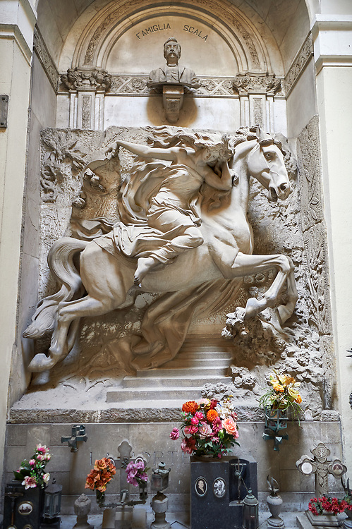 Pictures of the stone sculptured monumental tombs of a women on a charging horse. The Scala Tomb sculpted by E Sclavi 1913. Section A, no 36, The Staglieno Monumental Cemetery, Genoa, Italy .<br /> <br /> Visit our ITALY PHOTO COLLECTION for more   photos of Italy to download or buy as prints https://funkystock.photoshelter.com/gallery-collection/2b-Pictures-Images-of-Italy-Photos-of-Italian-Historic-Landmark-Sites/C0000qxA2zGFjd_k<br /> If you prefer to buy from our ALAMY PHOTO LIBRARY  Collection visit : https://www.alamy.com/portfolio/paul-williams-funkystock/camposanto-di-staglieno-cemetery-genoa.html