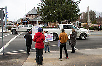 Supporters for the resignation of Dawn Johnson line both sides of North Main Street in downtown Laconia early Monday morning.  (Karen Bobotas Photo/for The Laconia Daily Sun)