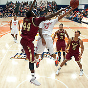 Cal State Fullerton shooting guard, MICHAEL WILLIAMS (#10), scores a bucket against Santa Clara University forward, YANNICK ATANGA (#44).  The Cal State Fullerton men's basketball team defeated the Santa Clara Broncos 86-73, at Titan Gym in Fullerton, California, on 11/16/2013.  Photo: Michael Der/  Sports Shooter Academy