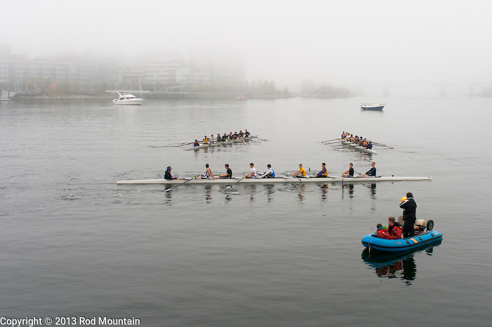 A rowing team trains on the foggy waters of the Burrard Inlet. Vancouver, BC. Photo: © Rod Mountain