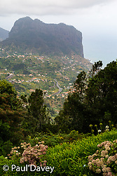 The distant 590m Penha de Aguia rises up above Porto da Cruz, seen from Portela, in the north east of the island of Madeira.  MADEIRA, September 25 2018. © Paul Davey