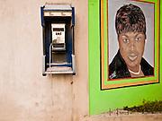 19 NOVEMBER 2010 - PORT-AU-PRINCE, HAITI: A phone booth on a wall next to a beauty salon in Port-au-Prince, Haiti. PHOTO BY JACK KURTZ