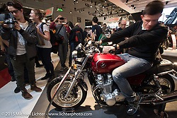 A retro offering in the 20,000+ square foot Honda display booth at EICMA, the largest international motorcycle exhibition in the world. Milan, Italy. November 21, 2015.  Photography ©2015 Michael Lichter.