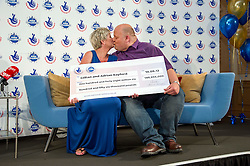 © Licensed to London News Pictures. 20/11/13 Adrian and Gillian Bayford a couple who scooped a £148million lottery jackpot are to divorce - just over a year since their win FILE PHOTO: 14/08/2012 Hatfield Heath, UK. Euromillions lottery winners Adrian and Gillian Bayford from Haverhill, Surrey celebrate their win at the Down Hall Country House Hotel. The pair banked the second biggest UK lottery win of £148,665.00. Photo credit : Simon Jacobs/LNP