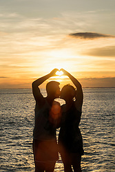 Silhouette of couple making heart shape with hands, Nusa lembongang, Bali, Indonesia